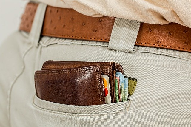man with traditional wallet in pocket